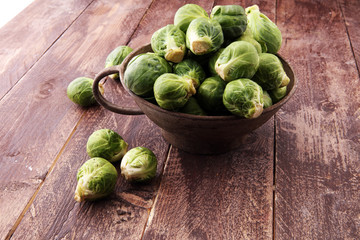 Printed roller blinds Brussels Fresh brussel sprouts over rustic wooden texture and in a vintage bowl.