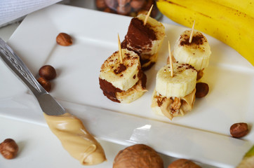 Banana, nuts, chocolate, walnuts. Healthy diet meal. Banana sweet