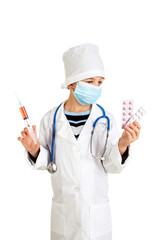 Medical treatment. Doctor with a syringe blood sampling and pills.