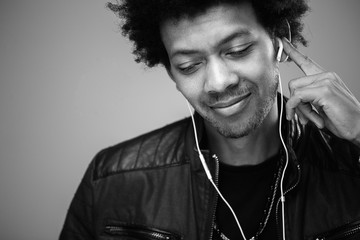 closeup portrait of handsome African American man listening to music