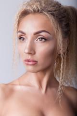 beautiful sexy blonde girl in black body with plump lips in studio