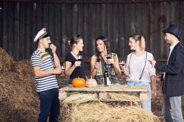 Group of adults drinking and having fun on halloween party