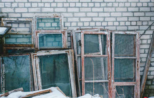 Old wooden window frames stand on the street\