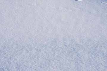 Photographed close-up of white snow lying on the ground after a snowfall, snow-covered surface, a small DOF, winter season
