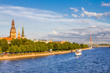 view from Zapadnaya Dvina embankment to Riga Dome Cathedral and St. Peter's Church Panorama under Rainy Clouds in Sunny Day in Latvia