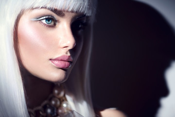 Fashion model girl portrait. Beauty woman with white hair and winter style makeup