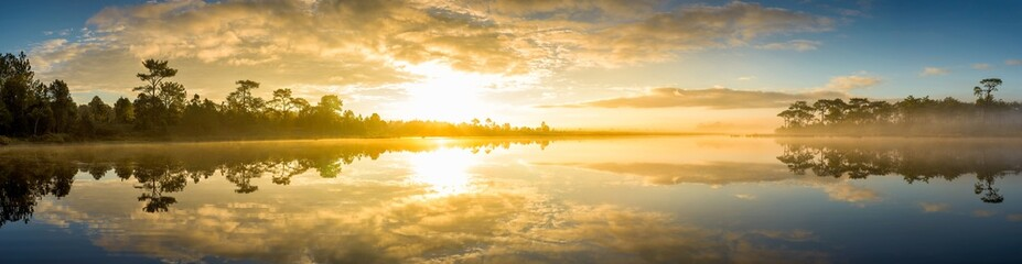 Foto op Canvas Meer / Vijver Panoramic view of sunrise over the lake in nation park, Beautiful rainforest landscape with fog in morning, Thailand