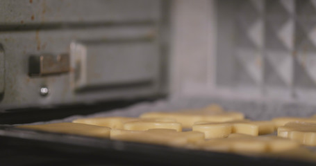 Placing cookies into oven