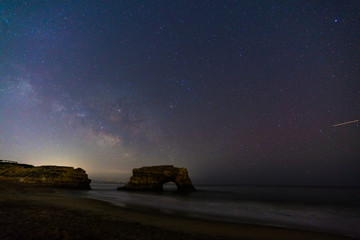 Milky way over natural bridges state beach, California