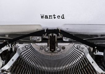 Wanted message typed on a old vintage typewriter. Close up