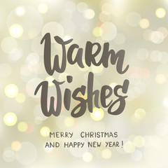 Warm wishes text, hand drawn letters. Holiday greetings quote. White and gold sparkling glowing lights.