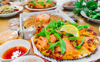 Smoked Salmon Pizza and Gyoza Dumplings, Combination of Popular Eastern and Western Food