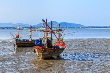Traditional fishing boat on beach during low tide at Prachuap Khiri Khan