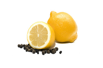 Lemon and black pepper. One whole lemon and its half and black pepper in peas isolated on white background