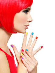 Closeup face of a beautiful  girl with  multicolor nails.