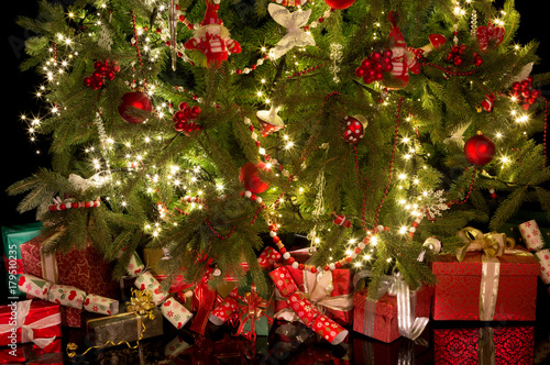 Crackers and gifts under the christmas tree\