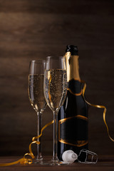 Picture of two glasses with champagne, bottle, cork