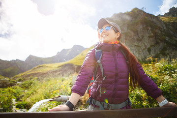 Photo of woman in sunglasses against of mountains
