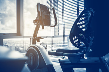 close up treadmill in fitness room background with color tone and light flare effect
