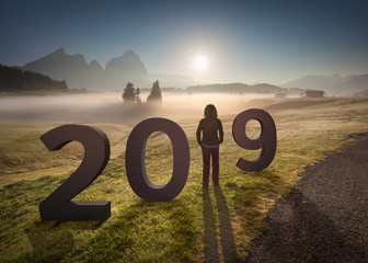 2019 numbers with girl looking forward to future