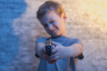 the boy with the gun pointing,