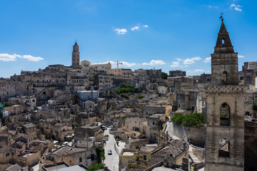 Panoramic view of the ancient town of Matera (Sassi di Matera), European Capital of Culture 2019, under blue sky, Basilicata, southern Italy