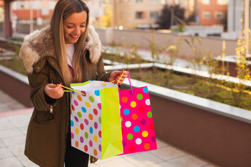 Surprised girl holding shopping bags