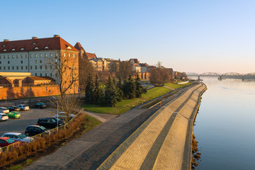 Torun city and river promenade in foggy morning. View from the Pilsudski bridge.