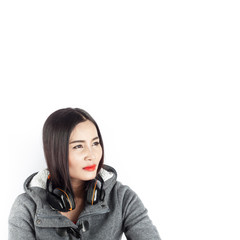 Beautiful asian girl from Thailand listen music from Headphones on white background