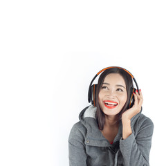 Beautiful asian girl from Thailand listen music from Headphones and sing song on white background