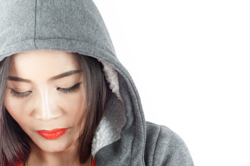 Beautiful asian woman cover head with hood
