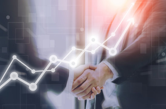 Businessman making handshake with a businesswoman on futuristic technology connection shape motion blur background with graph and chart rise up.Greeting and dealing business success concepts.