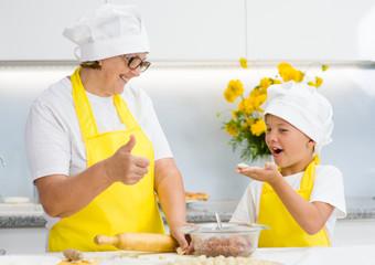 grandmother teaches her grandson to sculpt a dumplings
