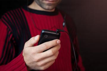 Man listening music with earphones.