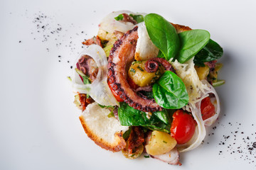 Salad with octopus and vegetables close up