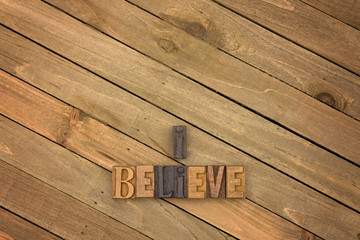 I Believe Spelled on a Wooden Table