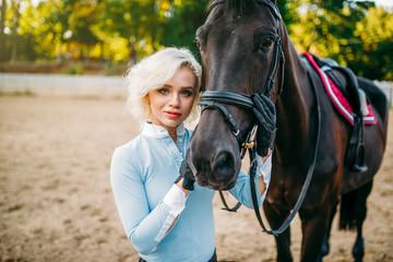 Female jockey and horse, horseback riding