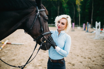Woman hugs her horse, friendship, horseback riding