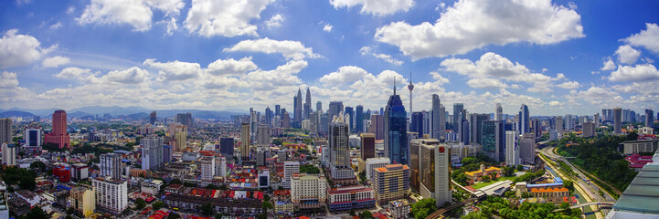 Door stickers Kuala Lumpur Panorama view of Kuala Lumpur city skyline with dramatic cloud formation and blue sky.