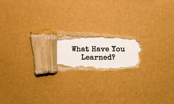 The text What Have You Learned appearing behind torn brown paper
