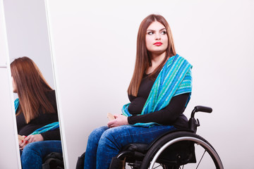 Disabled girl looking at relfection.