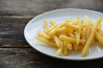 French fries on white dish