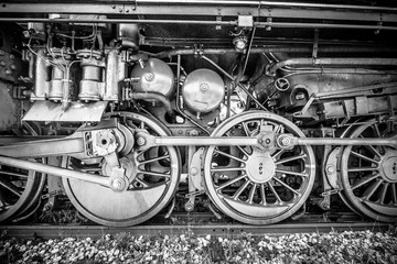 Wheels of an old steam locomotive.