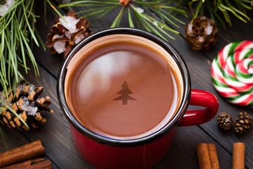 Christmas tree in a mug of cocoa. Top view
