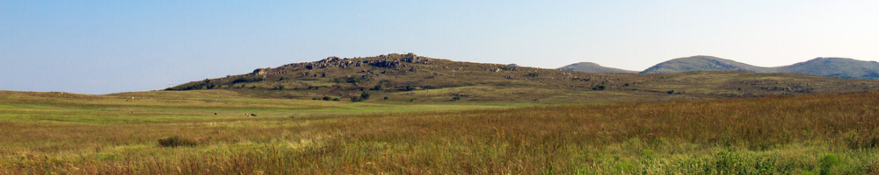 Wide panorama of prairie and distant mountains at Wichita Mountains Wildlife Refuge in Oklahoma