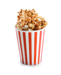 Cup with tasty caramel popcorn on white background