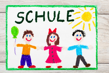 Photo of  colorful drawing: German word SCHOOL and happy children. First day at school.