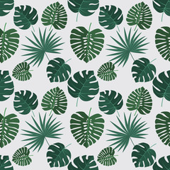 Vector green illustration of palm leaves background. Exotic seamless pattern