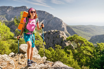 woman hiker with backpack walking at summer Lycian Way in Turkey