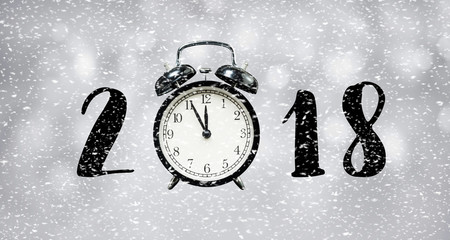 2018 new year countdown concept with time clock and snowfall